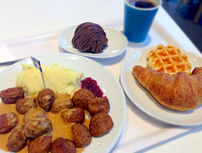 High angle view of meatballs and croissant served in plates