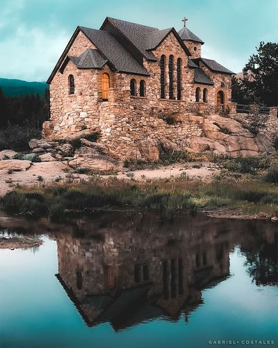 Chapel on the Rocks Colorado Church Chapel Sky Nature No People Lake House Day Outdoors Sunlight Residential District Plant Tree