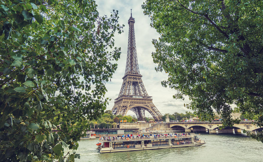 view of the eiffel tower in paris Paris Paris, France  Place Du Trocadero Summertime Tourist View Architecture City Europe Group Of People Gustave Eiffel History Nature Outdoors River Saine Ship Sky Tourism Tourismus Tower Travel Travel Destinations Tree Water