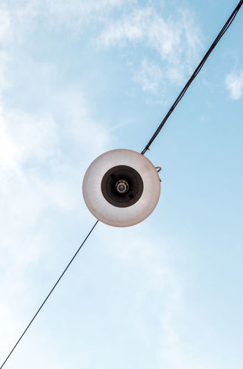 Low angle view of street light against sky