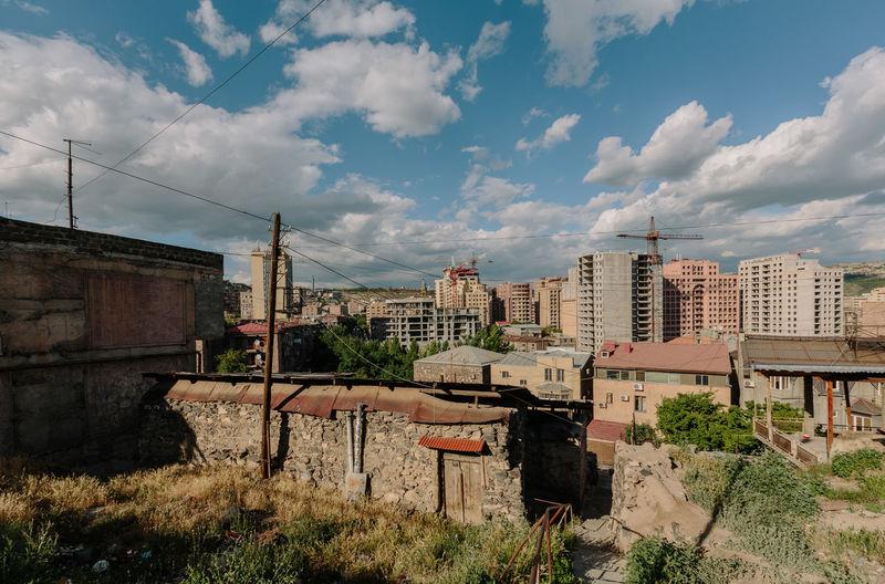 Old buildings in city against sky