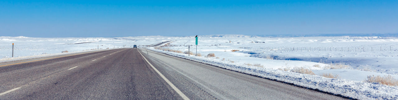 Cold Temperature Covering Day Diminishing Perspective Highway January Landscape Non-urban Scene Outdoors Road Scenics Season  Sky Snow The Way Forward Vanishing Point Weather White Color Winter