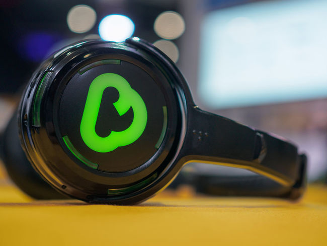 Headphones at Google Cloud Next London '18 Headphones London Excel Close-up Focus On Foreground Google Google Cloud Next London '18 Google Cloud Platform Green Color London Excel Table Technology