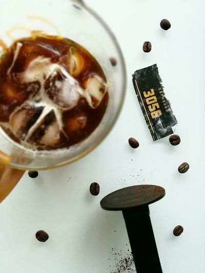 Morning elixir Food And Drink High Angle View No People Close-up Indoors  Freshness Coffee Caffeine Espresso Ice Coffee Focus On Background Coffee Beans Elixir Glass White Background Food Stories