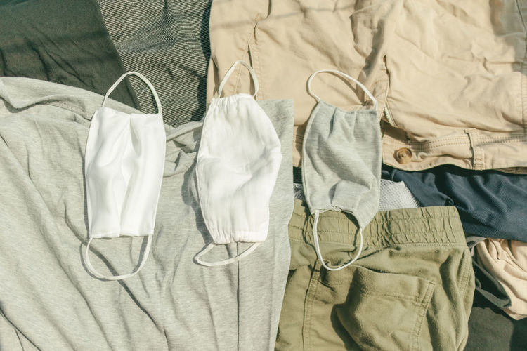 Hygienic mask and clothes being dried on hot sun to kill virus.
