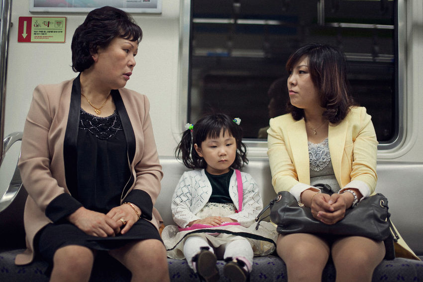Korean Subway Lifestyle Sitting Women Females Three Quarter Length Girls Front View Child Childhood Mother Family Indoors  Group Of People Casual Clothing Parent Real People Daughter Looking Lifestyles Hairstyle Subway Train - Vehicle Human Connection