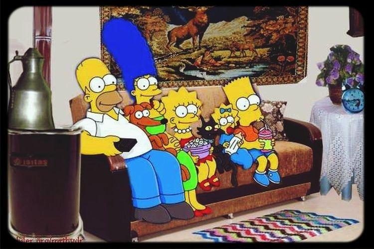 The Simpsons Homer Simpson Marge Simpson LisaSimpson bart simpsons megie simpson santas little helper snowball popcorn sofa