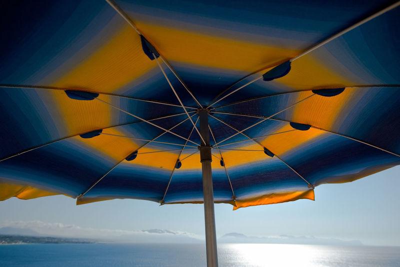 Umbrella Against Calm Blue Sea