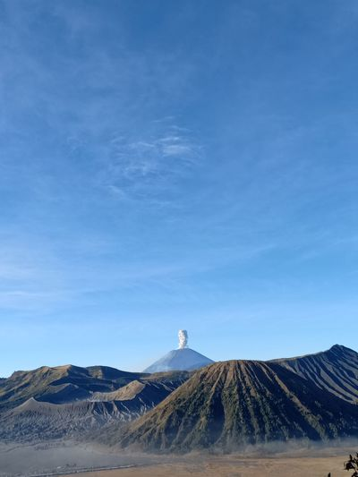 Morning view of volcanic bromo mountain against blue sky
