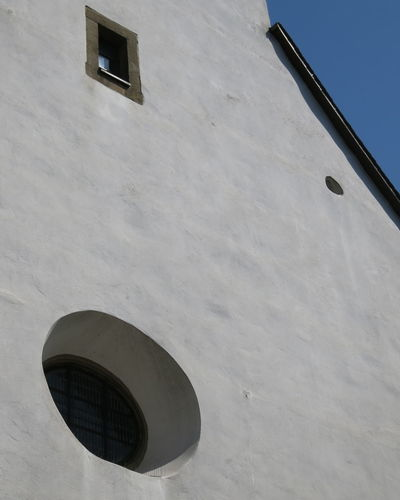 Windows at catholic church of Schloss Neuhaus by Paderborn / Germany Architectural Detail Architectural Details Architecture Building Exterior Built Structure Church Windowc Circular Window Day Exterior Low Angle View No People Outdoors Sky Wall Structure White White Wall Whitewashed Window Windows