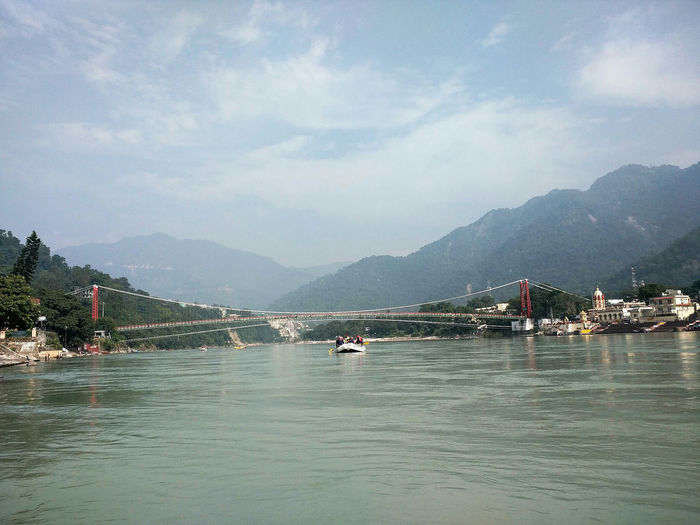 Mountain Water Mountain Range Cloud - Sky Nautical Vessel Outdoors Beauty In Nature Nature Sky Pedal Boat Day People Haridwar Rishikesh River River Drafting LaxmanJhula Ganga Beauty In Nature Vacations Uttarakhand Reflection Enjoying Life Taking Photos Finding New Frontiers