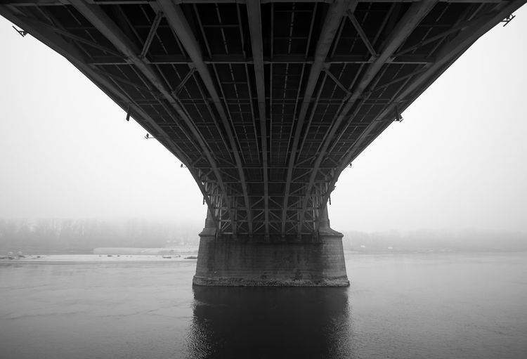 Bridge Architecture Bridge - Man Made Structure No People River Low Angle View Underneath Warsaw Blackandwhite Black And White Bnw Fog Foggy Weather Foggy Landscape Day Waterfront Water Symmetry Nature Urbanphotography Cityscape City Built Structure Vistula River