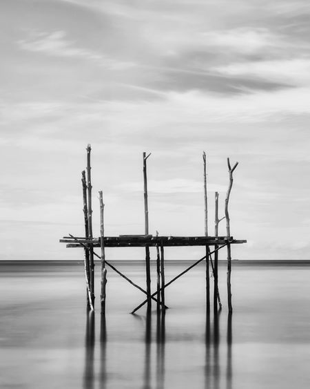 Fine art Seascape Fine Art Photography Cloud - Sky Water Waterfront Sky Sea No People Scenics - Nature Tranquility Nature Day Tranquil Scene Reflection Beauty In Nature Horizon Horizon Over Water Wood - Material Outdoors Non-urban Scene Bird Wooden Post Fine Art Fine Art Painting Fine Art Portrait Fhahry