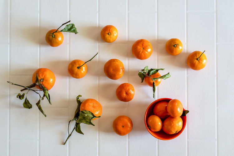 High angle view of orange fruits on table