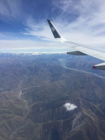 Views over Mount Cook while flying with Air New Zealand wing Aerial View Air Vehicle Aircraft Wing Airplane Beauty In Nature Cloud - Sky Day Environment Flying Landscape Mid-air Mode Of Transportation Mountain Nature No People Outdoors Plane Scenics - Nature Sky Transportation Travel