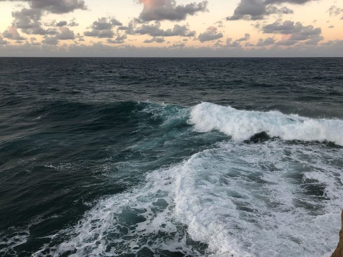 Wavy Puertoricotourism Puertorico Sea Horizon Over Water Water Nature Beauty In Nature Sunset Tranquil Scene Beach Wave Scenics No People Outdoors Cloud - Sky Sky Day Tranquility