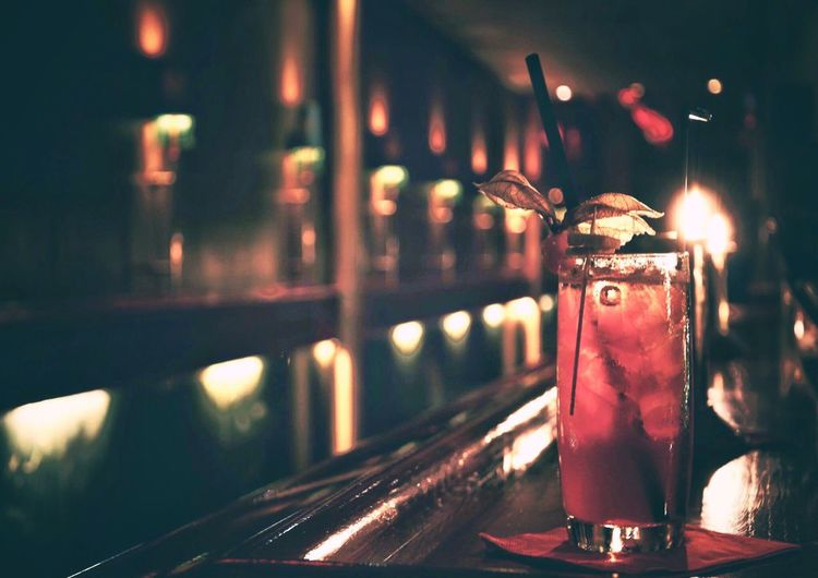 Close-Up Of Drink On Table At Illuminated Bar