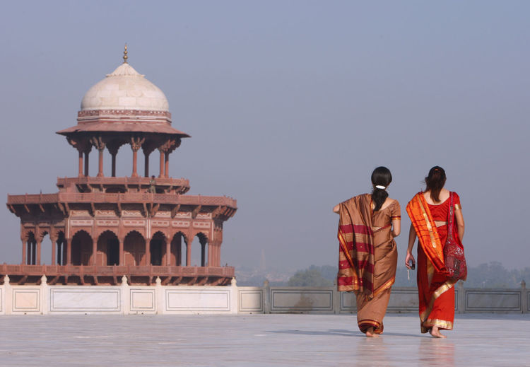 Taj Mahal Scene ASIA Asian  India Indian Taj Mahal Agra Architecture Asianwoman Asianwomen Building Exterior Built Structure Clear Sky Culture Culture Of India History Marble Palace Real People Rear View Sari Temple Architecture Tourism Traditional Clothing Travel Travel Destinations