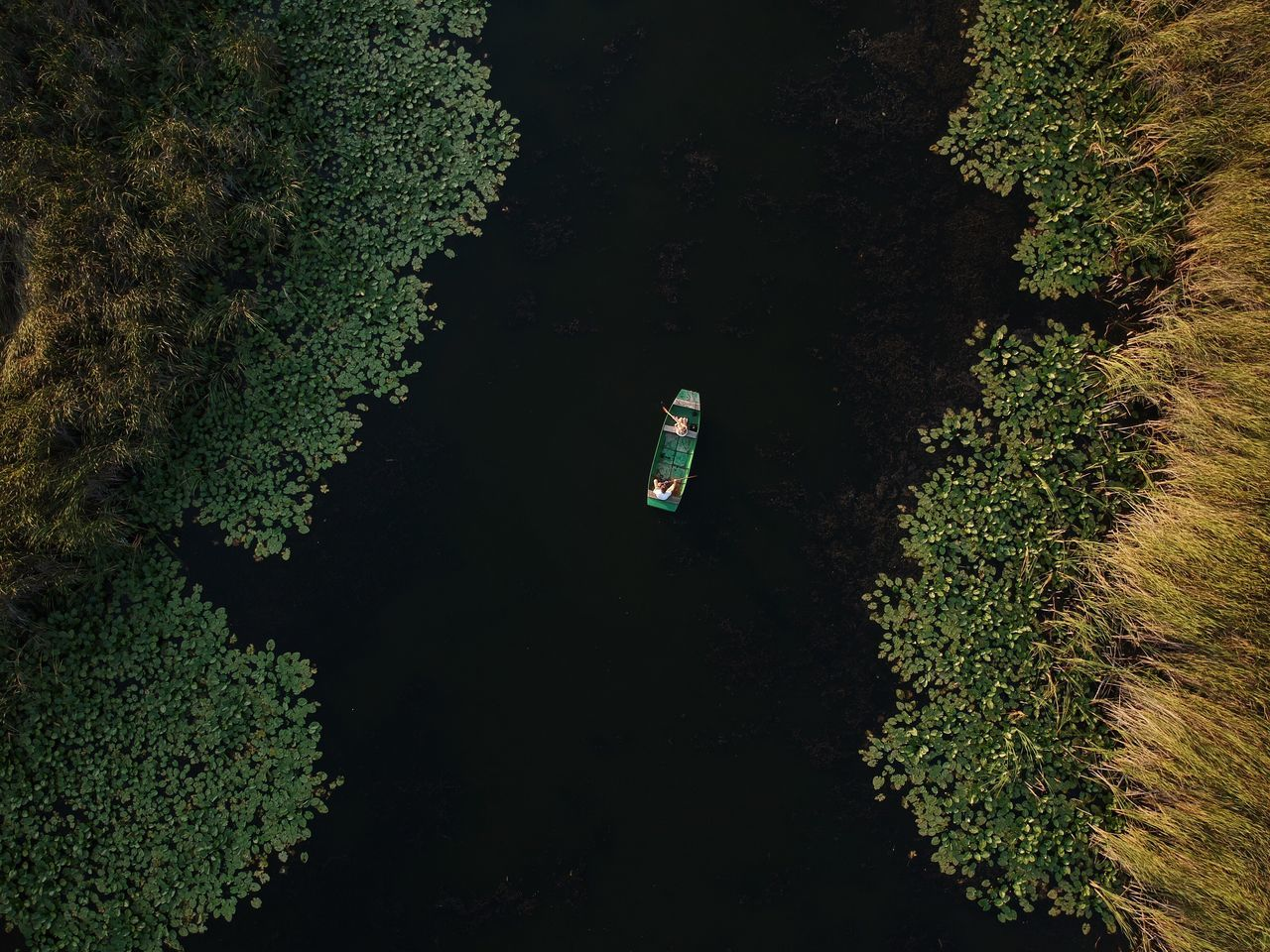 Aerial View Of A Boat On Lake