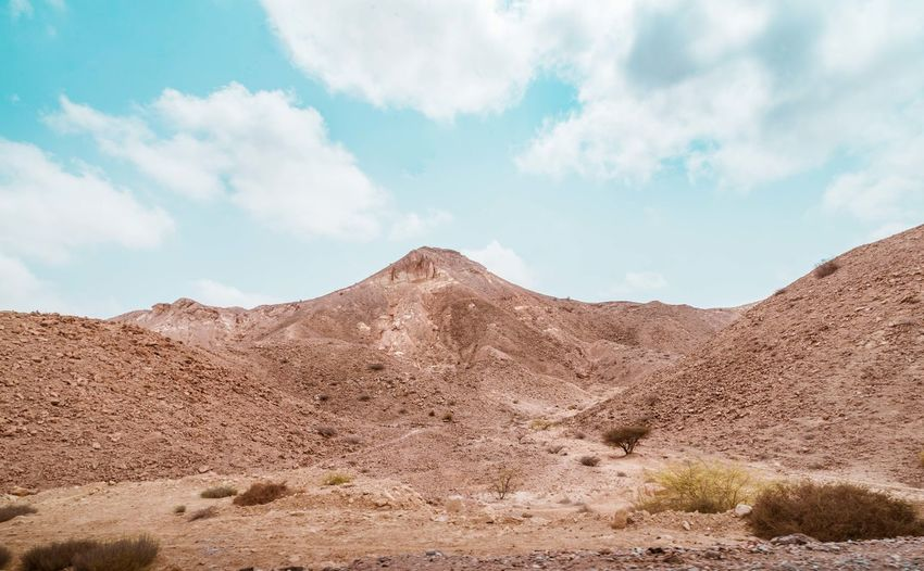 Oman Chapters Sky Cloud - Sky Scenics - Nature Landscape Environment Beauty In Nature Tranquil Scene Non-urban Scene Tranquility Mountain Land Desert Nature No People Day Arid Climate Climate Remote Extreme Terrain Physical Geography Mountain Range Outdoors Formation Semi-arid