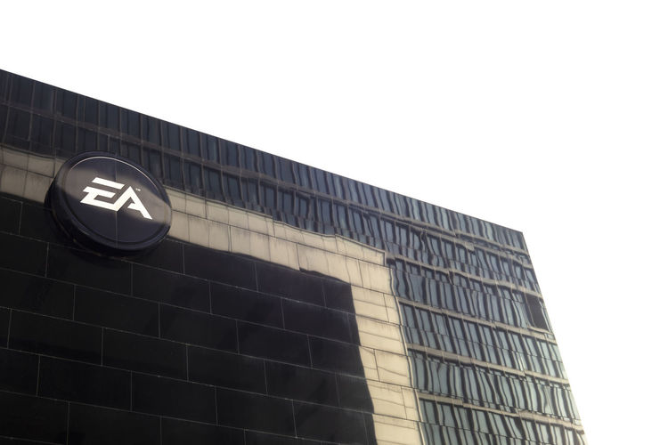 Low angle view of text on building against sky