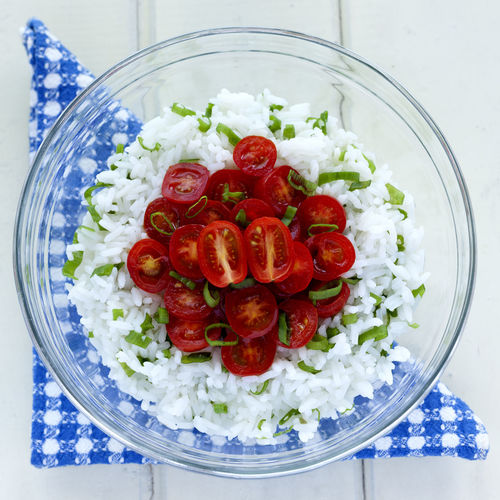 Rice and cherries tomatoes salad with Green onion in a glass bowl! Blue Napkin Bowl Cherries Tomatoes Close-up Day Directly Above Food Food And Drink Freshness Greek Food Green Onion Healthy Eating High Angle View Indoors  No People Picnic Ready-to-eat Rice Rice Salad Salad Studio Shot Summer Tomato Vegetable White Background