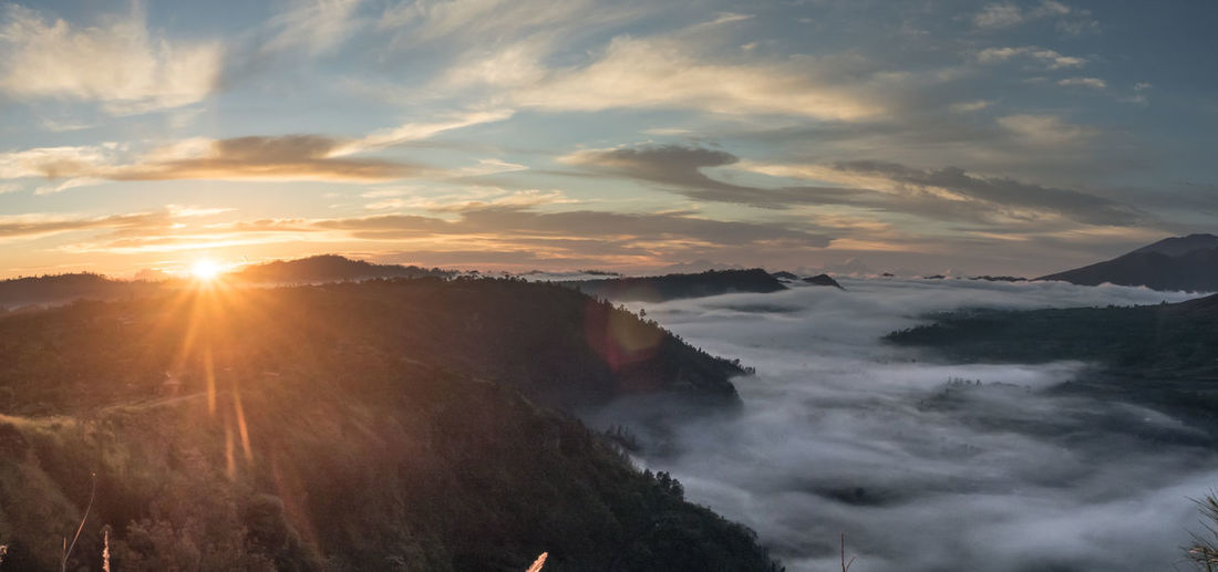 Panorama shot,Sunrise in Bali Bali Island Beauty In Nature Bukit Pinggan Majestic Misty Morning Misty Mountains  Nature The Great Outdoors - 2016 EyeEm AwardsPanorama Shot. Scenics Sunlight Sunrise Tranquil Scene Travel Destinations Original Experiences Bali Indonesia