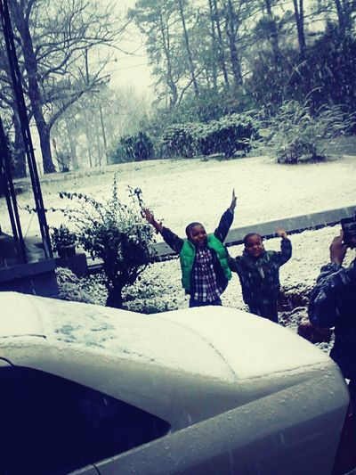 malik and jmaree in the snow.