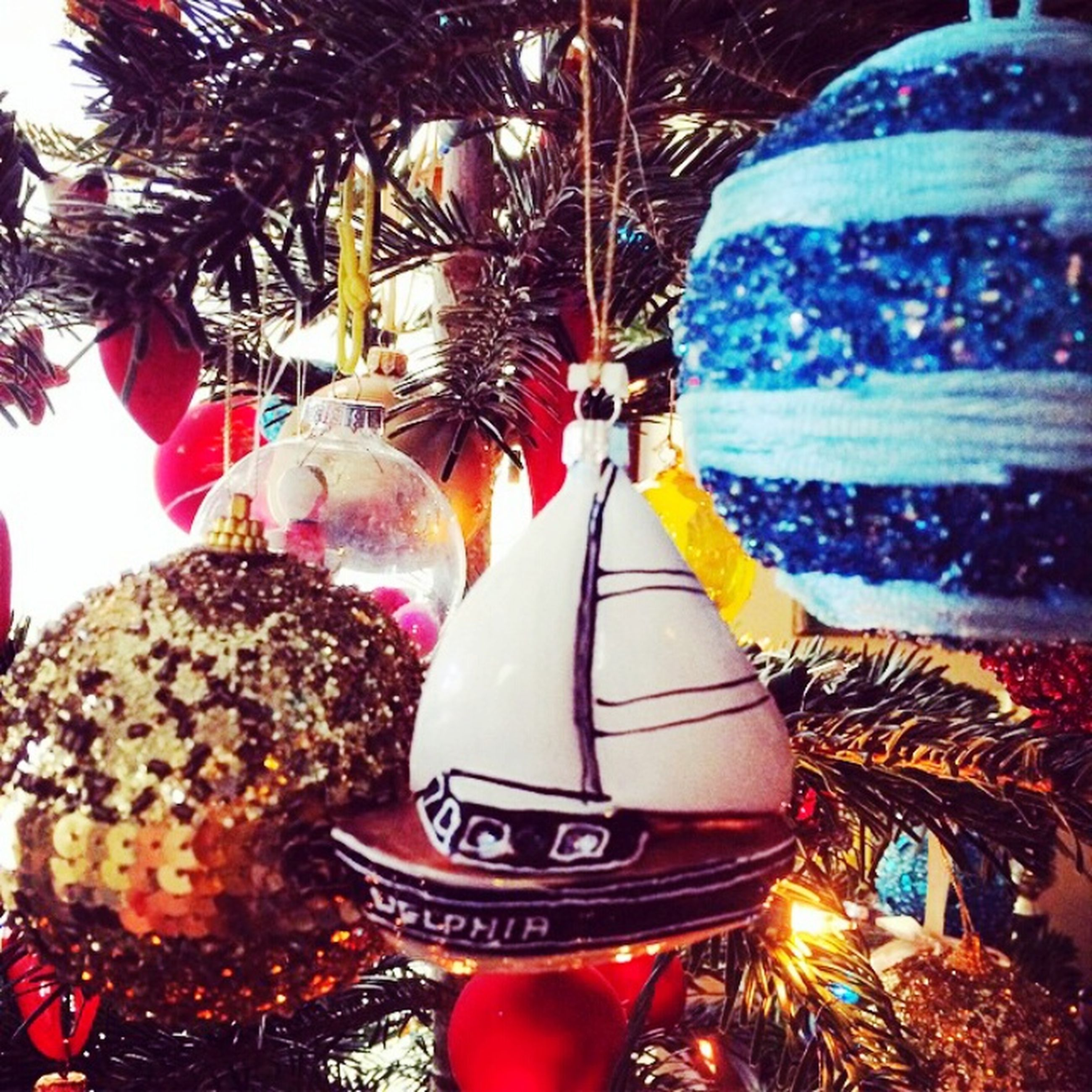 celebration, christmas, illuminated, close-up, decoration, hanging, tradition, christmas decoration, tree, focus on foreground, red, christmas tree, cultures, christmas ornament, lighting equipment, communication, sphere, text, traditional festival, no people