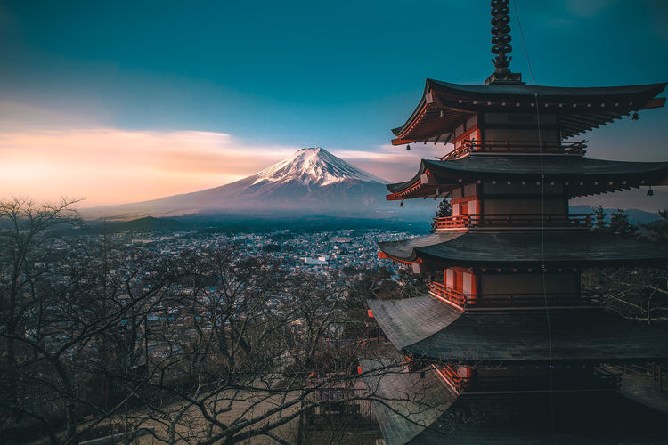 Shrine In City Against Snowcapped Mt Fuji During Sunset