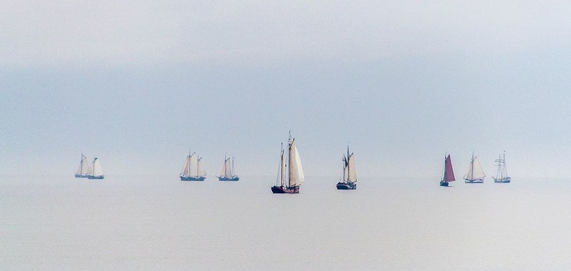 Old Dutch Sailing Ships between the isle of Terschelling and Harlingen