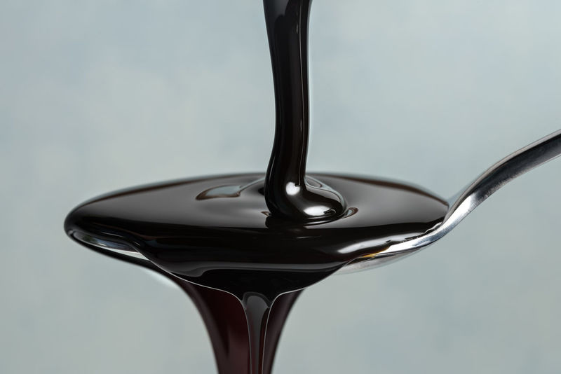 Molasses in motion Black Byproduct Food Food And Drink Ingredient Molasses Motion Spilling Spoon Sweet Sweetener Treacle