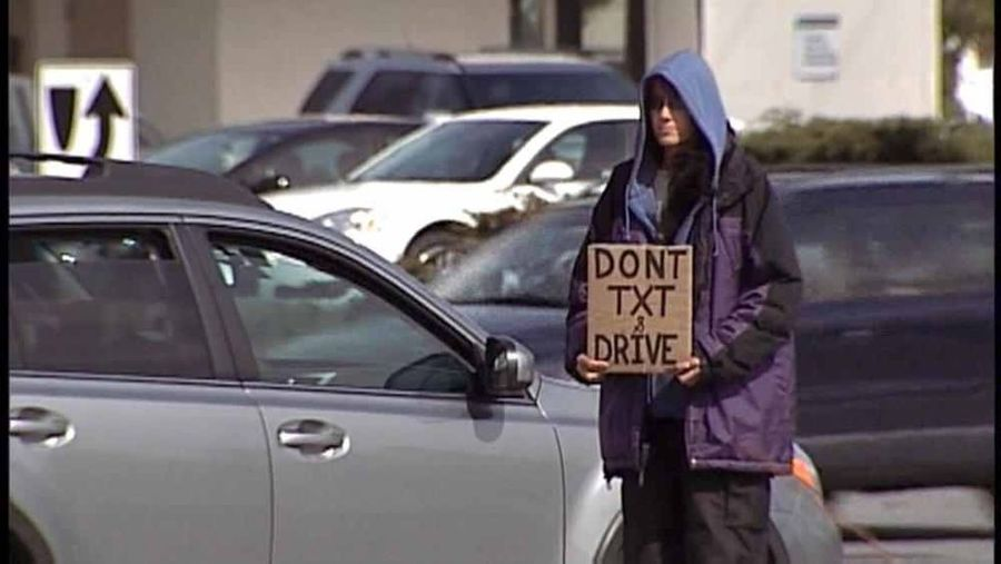 "This is me. That is the sign I flew for panhandling. Photo was taken in April 2013. I was featured on CNN and Yahoo News as ""The People And Places City Life Panhandling Homeless Homelessness  Texting Public Service Announcement Don't Text And Drive"