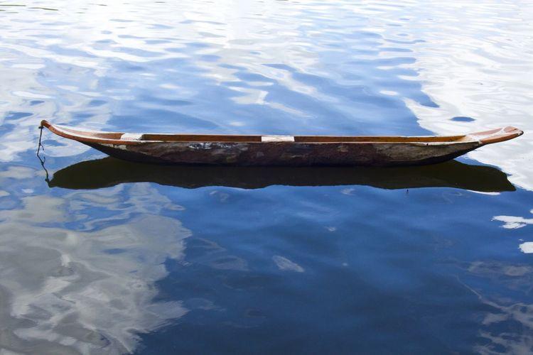 Canoe, by Paulo César Lima Beauty In Nature Boat Canoe Indigenous  Lake Tranquil Scene Water Wood