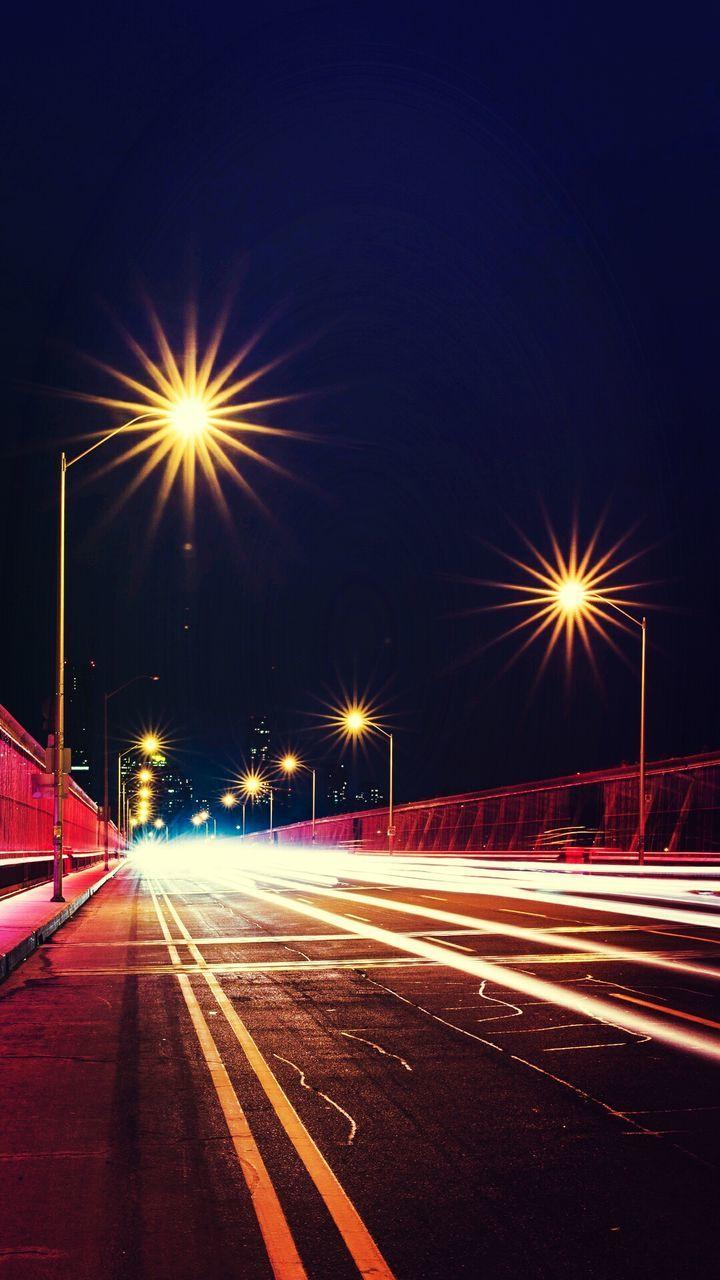 illuminated, night, speed, light trail, long exposure, street light, motion, transportation, lighting equipment, high street, road, blurred motion, street, no people, outdoors, clear sky, city, sky