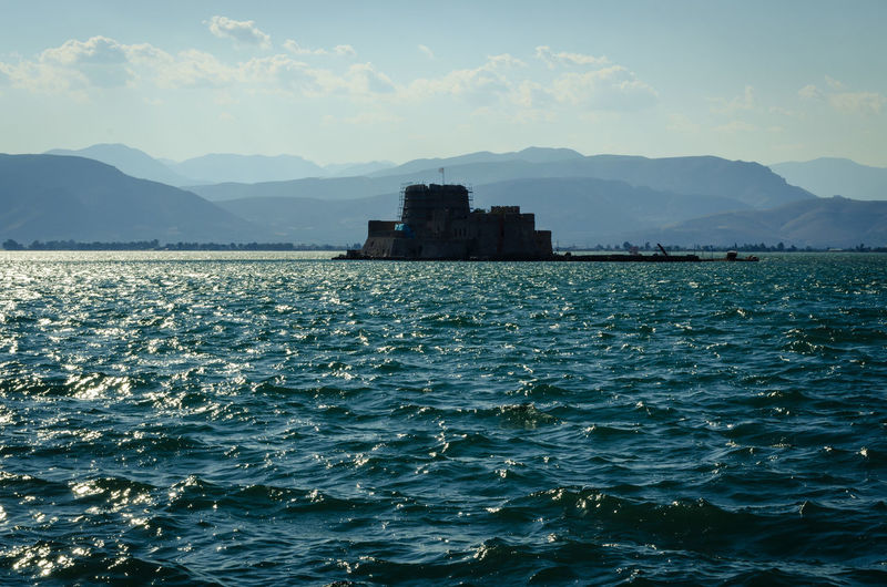 Castle Fortaleza Architecture Beauty In Nature Building Building Exterior Built Structure Cloud - Sky Day History Mountain Mountain Range Nature Nautical Vessel No People Outdoors Rippled Scenics - Nature Sea Sky Water Waterfront