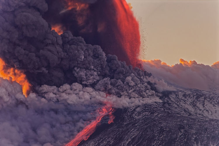 Scenic view of etna volcano eruption at sunset
