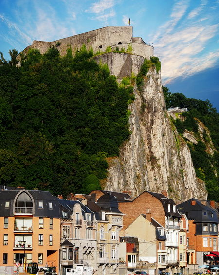 View of Dinant, a city located on the River Meuse in the Belgian province of Namur. Belgium Belgium Architecture Building Exterior Built Structure Castle Cliff Day Dinant Hill History House Mountain Nature No People Outdoors Sky Tree
