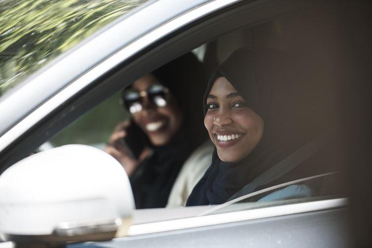 Portrait of smiling man in car