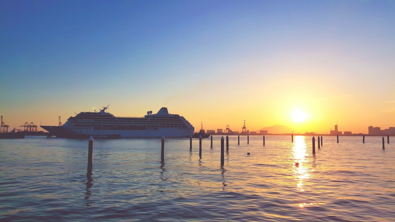 Cruise Ship On Sea Against Sky During Sunrise