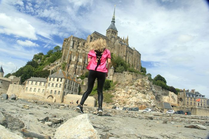 One Person Adults Only Adult Full Length Travel Destinations History Architecture One Woman Only Only Women People Tourism Built Structure Cloud - Sky Travel Sky Women Standing Vacations Outdoors Day Saint Michael Saint Michael's Mount Mont Saint-Michel City Life Girls