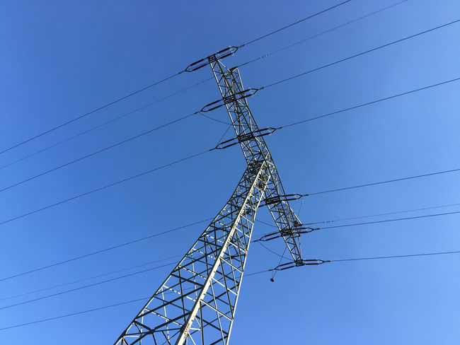 power from the grid view at the electrical tower Blue Cable Current Electric Current Electrical Current Electrical Tower Electricity  Electricity Pylon Energise Energised Energize Energized Energy Power Power Cable Power Line  Power Pole Power Supply Sky Utility Pole Wire