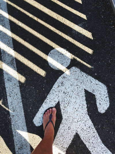 Low section of person on zebra crossing