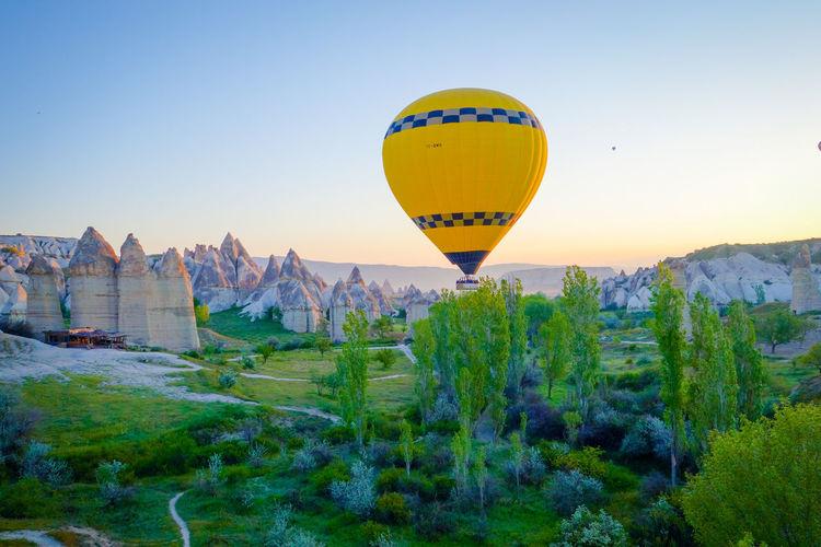 Hot Air Balloon Flying Over Cappadocia Against Clear Sky
