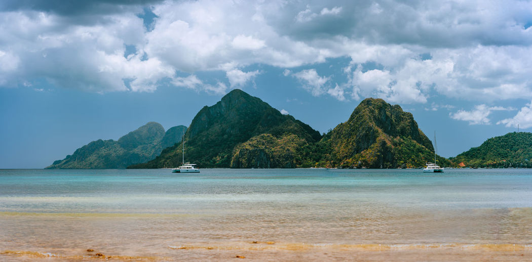 Palawan, Philippines. Aerial drone panoramic view of sandbar with lonely tourist boat in turquoise coastal shallow waters and coral reef in El Nido archipelago. Philippines Palawan Sea El Nido Adventure Tourism Coastline Peace Vacation White Southeast Asia Scene Banka Archipelago Beach Forest Lagoon Tropical Skylight Nido Island Outdoor Panorama Exotic Turquoise Golden Light Travel Tour Boat Ocean Corong Corong Turquoise Water Boat Holiday Beach Vacation Water ASIA Shore Getaway  Summer Hill Wallpaper Aerial Background Paradise Island Mountain Jungle Most Beautiful  Paradise Green Nature Paradise Beach Blue Water Well Known Aerial View Beach Sun Landscape Headland Sky Seascape Explore Rock Wall Wonder Corong Karst