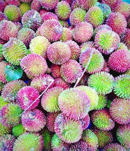 "Local fruit called ""Pulasan"" found at the farmer's market in Tanjung Malim Perak Nutrition Healthy Organic Raw Food Asian Fruit Tanjung Malim Perak, Malaysia Local Fruit Red And Green Sweet Farmers Market Stall Fruit Stall Street Fruit Backgrounds Full Frame Close-up Spiked"
