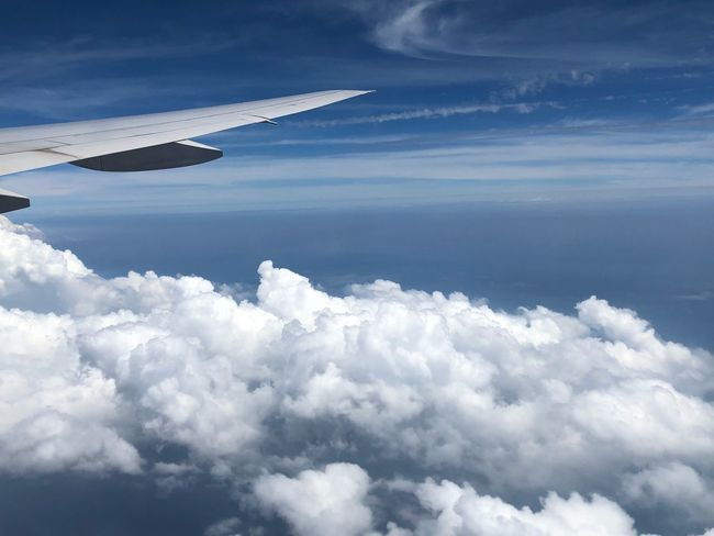 Cloud - Sky Sky Beauty In Nature Scenics - Nature Nature Tranquility Day No People Air Vehicle Flying Cloudscape Tranquil Scene Airplane Aerial View Outdoors Transportation Mode Of Transportation White Color Blue Idyllic