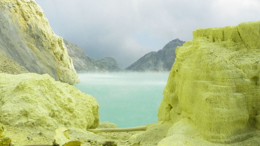 World of sulfur, Kawah Ijen, Indonesia. The lake contain almost pure sulphiric acid with a pH less than 0,5 and it is the largest highly acidic crater lake in the world. The surrounding rocks are covered by pure sulfur that makes the landscape spectacular. Acid Acid Lake Beauty In Nature Crater Crater Lake Geology Kawah Ijen Lake Landform Mountain Natural Nature Nature No People Other World Outdoors Rock - Object Scenics Sulfur  Sulphur Toxic Tranquil Scene Tranquility Volcanic Landscape Volcano