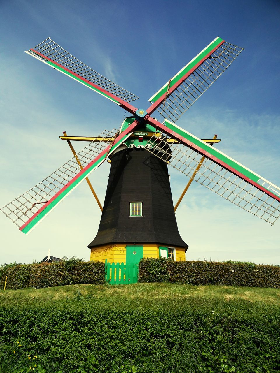alternative energy, wind power, renewable energy, environmental conservation, wind turbine, windmill, fuel and power generation, field, traditional windmill, industrial windmill, day, rural scene, outdoors, no people, nature, sky, grass, sustainable resources, built structure, low angle view, landscape, tree, architecture, beauty in nature