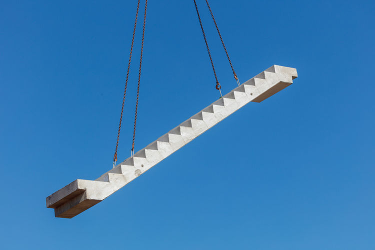 Low angle view of steps against clear blue sky